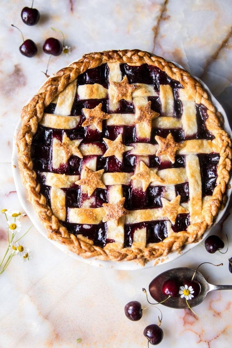 "<p>Cherries, red wine, and butter are the most notable ingredients in this exciting recipe. It's boozy, sweet, tart, tangy, and everything you could wish for in a fruity dessert. Top it off with crisp vanilla-bean ice cream for best results.</p> <p><strong>Get the recipe</strong>: <a href=""https://www.halfbakedharvest.com/mulled-cherry-bomb-pie/"" class=""link rapid-noclick-resp"" rel=""nofollow noopener"" target=""_blank"" data-ylk=""slk:mulled cherry bomb pie"">mulled cherry bomb pie</a></p>"