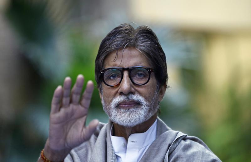 """FILE - In this Feb. 9, 2013 file photo, Bollywood star Amitabh Bachchan speaks to the media during a charity event in Mumbai, India. Bollywood's biggest star Bachchan has asked his fans to save water during the Hindu festival of colors as several parts of western India are facing a drought. """"I have expressed that we play a dry Holi without water,"""" Bachchan said on his Facebook page on Tuesday, March 26, 2013. The Holi festival is on Wednesday and is celebrated by playing with dry colors as well as colored water.  (AP Photo/Rafiq Maqbool, file)"""