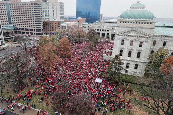 PHOTO: Thousands of Indiana teachers wearing red surround the Statehouse in Indianapolis, Nov. 19, 2019, for a rally calling for further increasing teacher pay amid a wave of educator activism across the country. (Michael Conroy/AP)