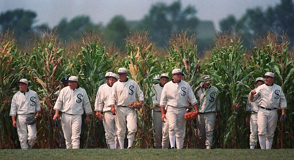 """Ghost Players emerge from the cornfield at the """"Field of Dreams"""" movie site in Dyersville, Iowa, in this undated file photo.  Eight years after the movie the Ghost Players are making appearances around the country where they provide baseball instruction and baseball stunts. (AP Photo/Charlie Neibergall)"""