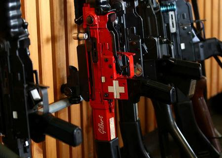 FILE PHOTO: A rifle with a Swiss flag is pictured during a competition in Romont