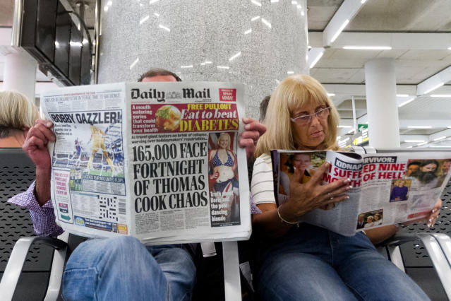 British passengers wait for news on cancelled Thomas Cook flights at Palma de Mallorca airport on Monday, Sept. 23, 2019. Spain's airport operator AENA says that 46 flights have been affected by the collapse of the British tour company Thomas Cook, mostly in the Spanish Balearic and Canary archipelagos. (AP Photo/Francisco Ubilla)