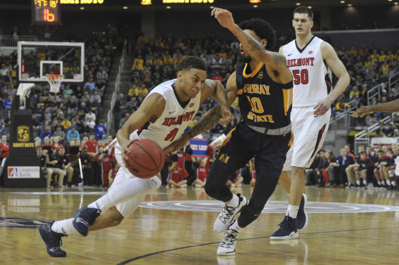Murray State's Tevin Brown (10) guards Belmont's Kevin McClain (11) as he drive the ball to the basket during the first half of an NCAA college basketball game in the championship of the Ohio Valley Conference basketball tournament, Saturday, March 9, 2019, in Evansville, Ind. (AP Photo/Daniel R. Patmore)