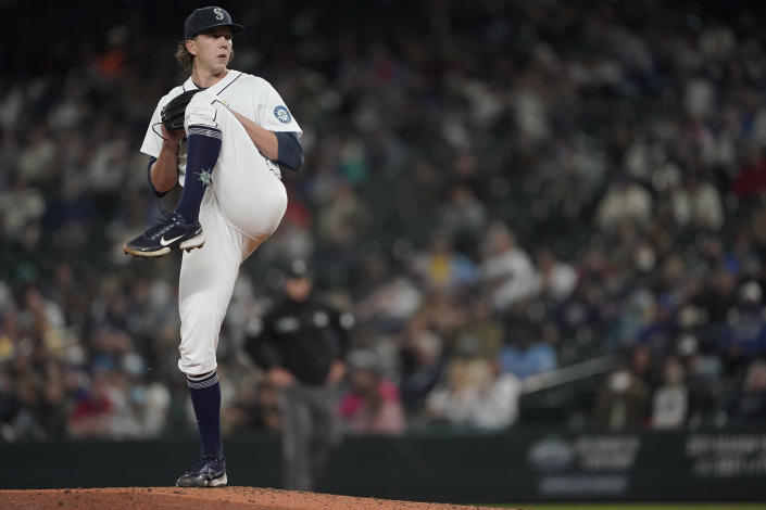 Seattle Mariners starting pitcher Logan Gilbert begins his windup against the Boston Red Sox during the fourth inning of a baseball game, Monday, Sept. 13, 2021, in Seattle. (AP Photo/Ted S. Warren)