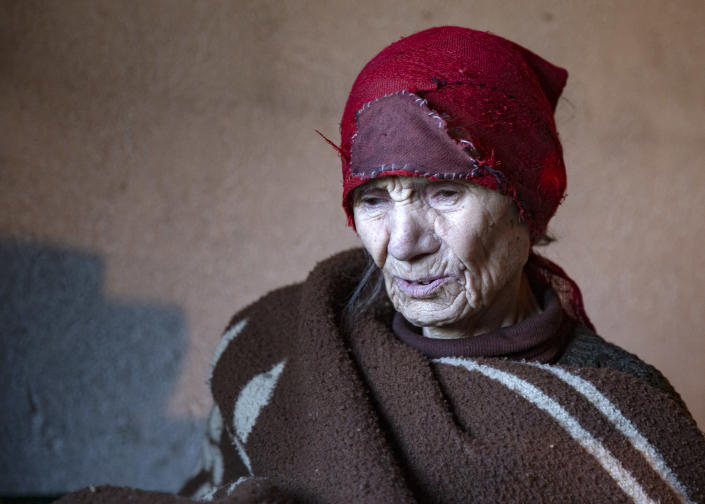 Kosovo Serb Blagica Dicic a lonely 92-year old woman in a remote village of Vaganesh, regularly visited by Kosovo Albanian neighbor Fadil Rama bringing food and groceries in Kosovo on Thursday, Nov. 19, 2020, abandoned by all her former ethnic Serb neighbors. (AP Photo/Visar Kryeziu)