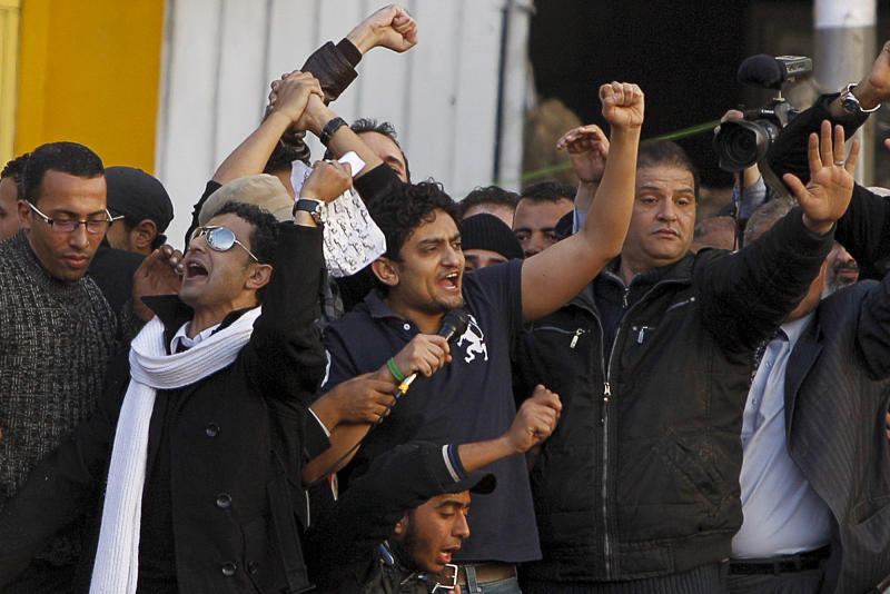 "FILE - In this Feb. 8, 2011 file photo, Egyptian Wael Ghonim, center, talks to the crowd in Tahrir Square, in Cairo, Egypt. Ghonim said late Thursday, Sept. 19, 2019 in a video on his twitter account that authorities raided his parents' house in Cairo and arrested his brother Hazem, whom he described as ""a political person"" and confiscated his parents' passports. Ghonim alleges that the Egyptian embassy in the U.S. threatened him the previous day ""something will happen"" if he didn't stop criticizing Egypt's government on social media.  (AP Photo/Tara Todras-Whitehill, File)"
