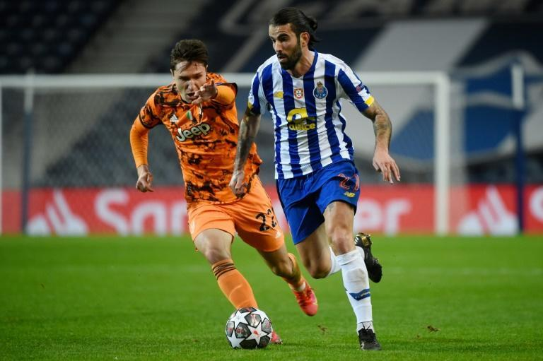 Italian forward Federico Chiesa (L) kept Juventus afloat with an away goal in Porto.