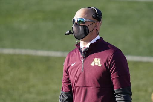 Minnesota head coach P.J. Fleck looks at the scoreboard during the first half of an NCAA college football game against Illinois Saturday, Nov. 7, 2020, in Champaign, Ill. (AP Photo/Charles Rex Arbogast)