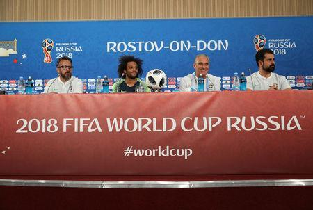 Soccer Football - World Cup - Brazil Press Conference - Rostov Arena, Rostov-on-Don, Russia - June 16, 2018 Brazil's Marcelo with Brazil coach Tite during the press conference REUTERS/Marko Djurica