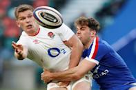England captain Owen Farrell (L) is in the sights of Japan's Top League