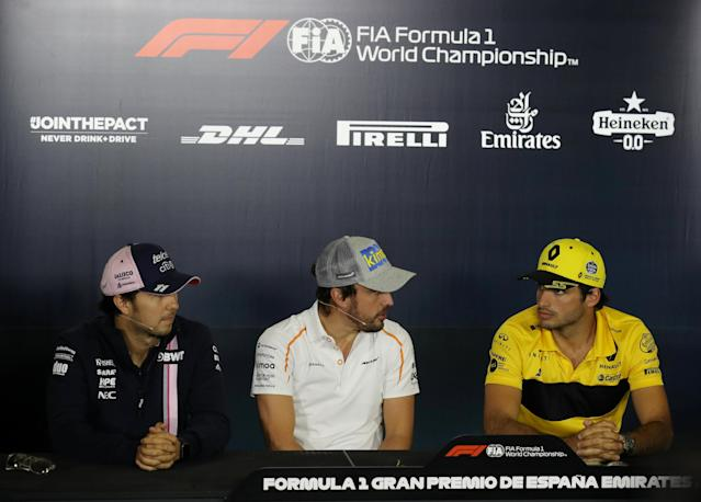 Formula One F1 - Spanish Grand Prix - Circuit de Barcelona-Catalunya, Barcelona, Spain - May 10, 2018 Force India's Sergio Perez, McLaren's Fernando Alonso and Renault's Carlos Sainz during a press conference ahead of the Spanish Grand Prix REUTERS/Albert Gea