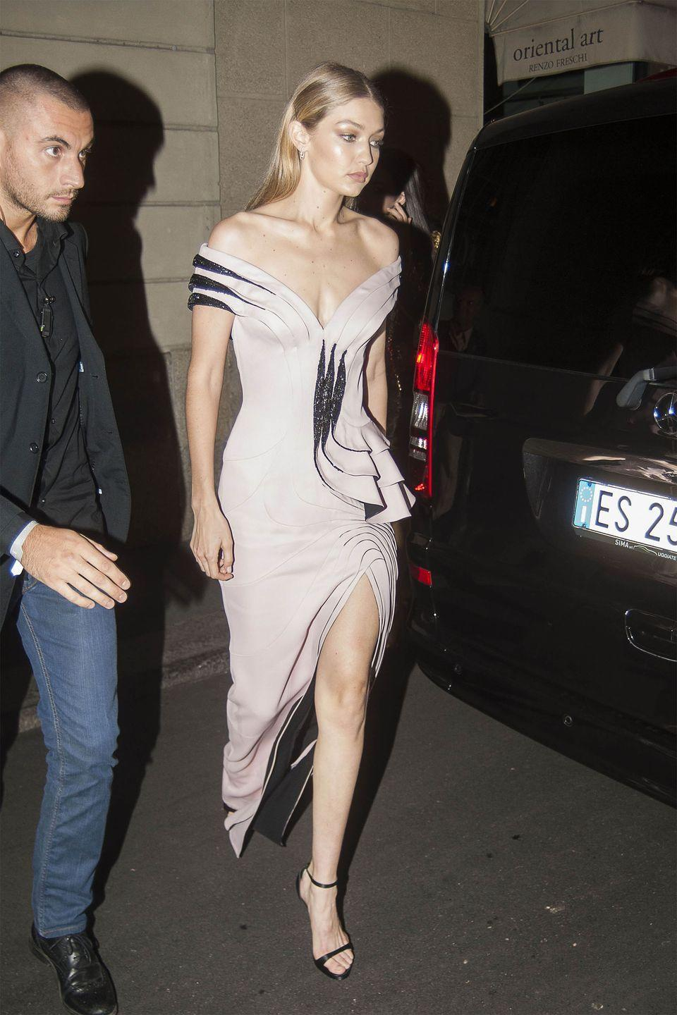 <p>In an Atelier Versace gown and heeled sandals while out in Milan. </p>