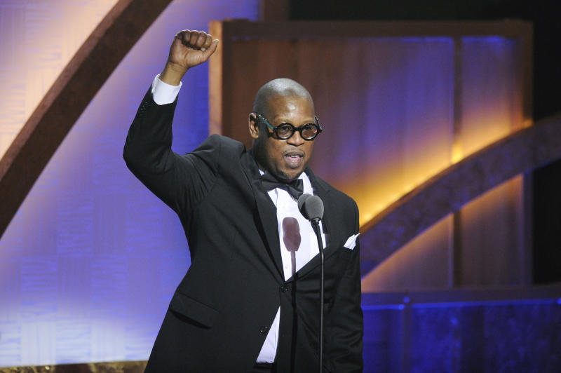 "FILE - In this Jan. 16, 2010 file photo, media executive Andre Harrell speaks during the 2010 BET Hip Hop Honors in Washington. Harrell, the Uptown Records founder who shaped the sound of hip-hop and R&B in the late '80s and '90s with acts like Mary J. Blige and Heavy D and also launched the career of mogul Sean ""Diddy"" Combs, has died, several members of the music community revealed late Friday, May 8, 2020. He was 59. (AP Photo/Nick Wass)"