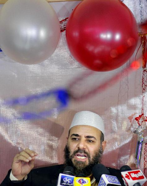 "Tarek el-Zomor a founding member of Gama'a Islamiyya , also leader and founder of the Building and Development Party, who was convicted with others of planning the assassination of late President Anwar Sadat in 1981, talks during a presser to celebrate the early results of an Islamist-backed constitution in Cairo, Egypt, Monday, Dec. 24, 2012. The Muslim Brotherhood, the main group backing the charter, claimed it passed with a 64 percent ""yes"" vote. The official results are expected on Monday, Dec. 24. (AP Photo/Amr Nabil)"