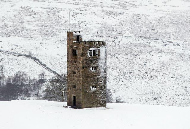 Snow surrounds Boots Folly in the Peak District