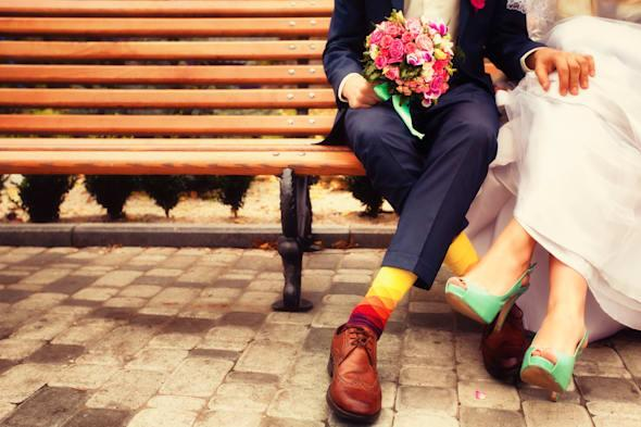Bride and groom in bright clothes on the bench