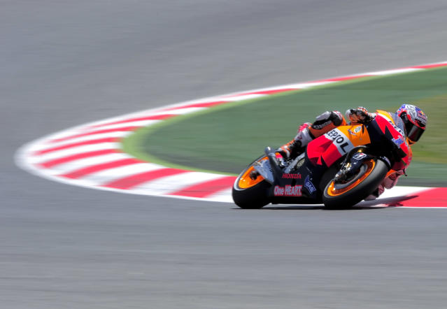 Repsol Honda Team's Australian Casey Stoner rides at the Catalunya racetrack in Montmelo, near Barcelona, on June 2, 2012, during the MotoGP qualifying session of the Catalunya Moto GP Grand Prix. AFP PHOTO / JOSEP LAGOJOSEP LAGO/AFP/GettyImages