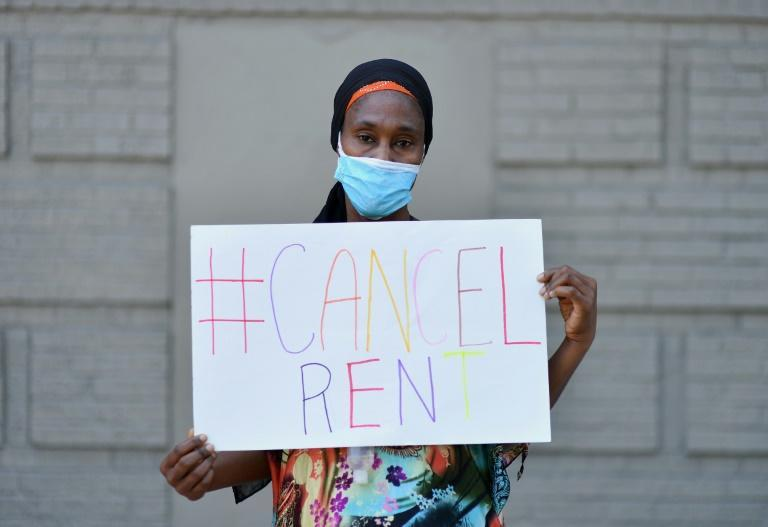 Mariatou Diallo, who has been unable to make her rent payment since March 2020, holds up a sign during a protest against evictions -- the US could soon be facing a major housing crisis sparked by pandemic-related joblessness