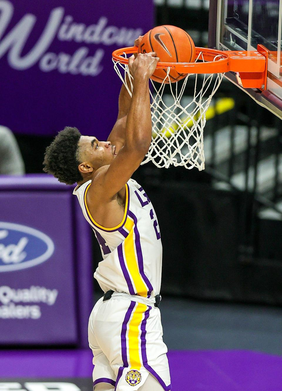 LSU Tigers guard Cameron Thomas (24) dunks the ball against the Texas A&M Aggies on a steal during the second half at Pete Maravich Assembly Center.