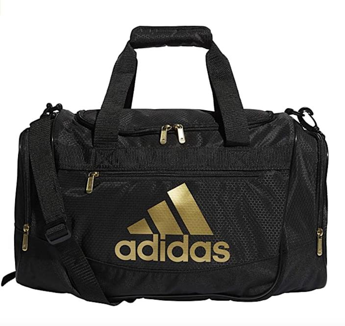 <p>The roomy and tall interior of this <span>Adidas Defender III Duffel Bag</span> ($35) allows for easy packing, while the two zippered end pockets make for convenient storage. It also comes with a lifetime warranty, so you know it's meant to last.</p>