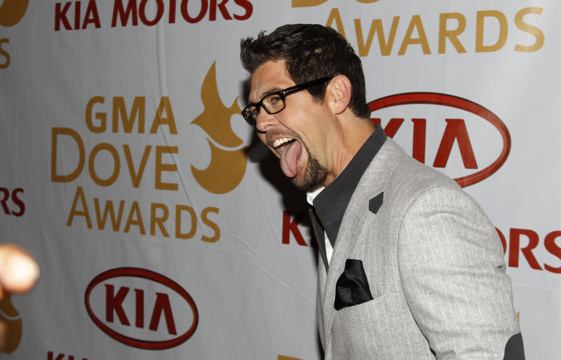 Gospel recording artist Jason Crabb jokes with photographers as he walks the red carpet before the Gospel Music Association Dove Awards at Atlanta's Fox Theater Thursday, April 19, 2012. Crabb is nominated for eight awards including artist of the year. (AP Photo/John Bazemore)