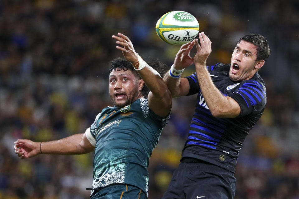FILE - In this Saturday, Sept. 25, 2021 file photo, Argentina's Matias Alemanno, right, and Australia's Rob Leota compete for lineout ball during the Rugby Championship test match between the Pumas and the Wallabies in Townsville, Australia. Eight members of Argentina's rugby touring squad are stuck between Australian states after a border mix-up just two days before their Rugby Championship match with the Wallabies on the Gold Coast. (AP Photo/Tertius Pickard,File)