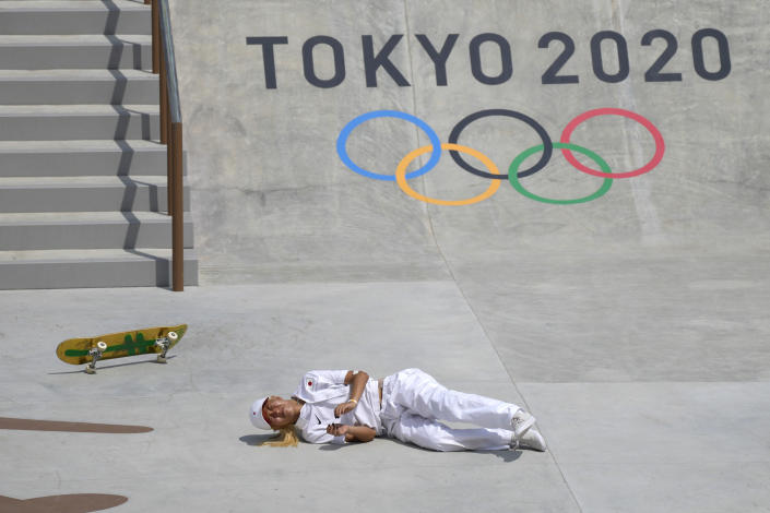 Aori Nishimura of Japan falls as he competes in the women's street skateboarding finals at the 2020 Summer Olympics, Monday, July 26, 2021, in Tokyo, Japan.(AP Photo/Ben Curtis)