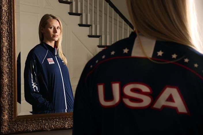 Hayley Hodson stands in her parents' Newport Beach home while wearing her U.S. Women's National Team jacket.