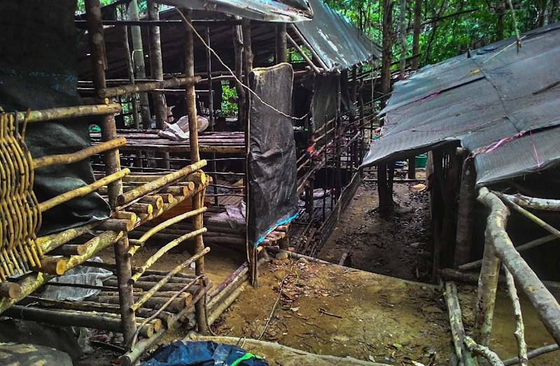 An abandoned migrant detention camp used by people-smugglers in a jungle near the Malaysia-Thailand, seen in a photo released by the Royal Malaysian Police (AFP Photo/)