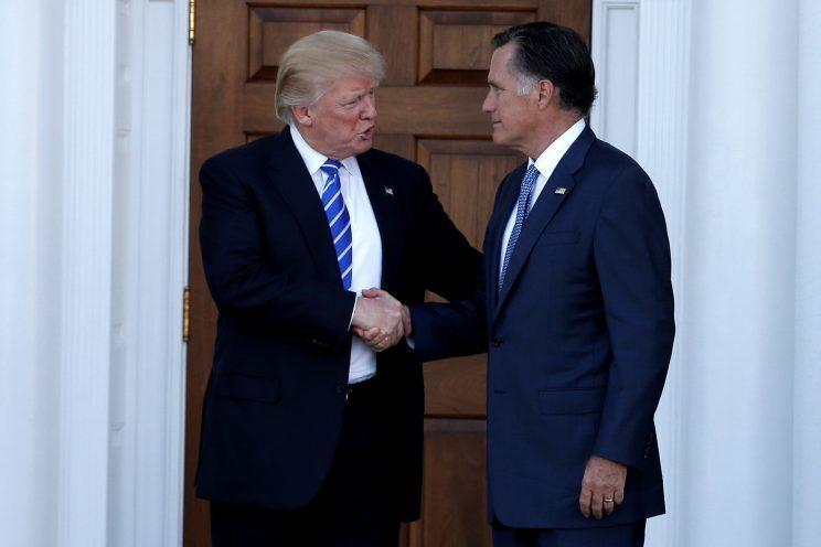 Donald Trump shakes hands with Mitt Romney after their meeting at Trump National Golf Club in Bedminster, N.J. (Photo: Mike Segar/Reuters)