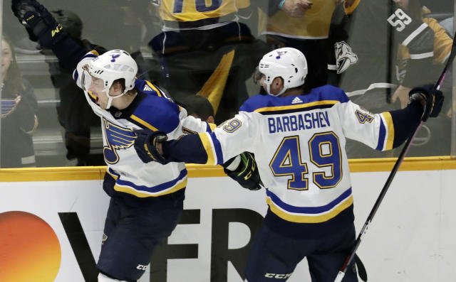 FILE - In this Feb. 10, 2019 file photo, St. Louis Blues right wing Vladimir Tarasenko, of Russia, left, celebrates with Ivan Barbashev (49), of Russia, after Tarasenko scored the winning goal in overtime against the Nashville Predators in an NHL hockey game in Nashville, Tenn. More than two decades since Fetisov and the Russian Five shattered the myth that NHL teams couldnt win with players from a nation unpopular in North America, Tarasenko and Barbashev are one victory away from lifting the same Cup after being inspired by the generation of countrymen who endured so much to get there. (AP Photo/Mark Humphrey, File)