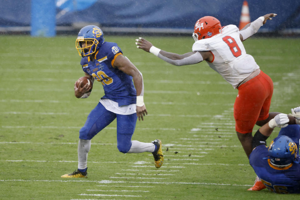 South Dakota State running back Pierre Strong Jr. (20) runs for yardage as Sam Houston State linebacker Quentin Brown (8) defends during the first half of the NCAA college FCS Football Championship in Frisco, Texas, Sunday, May 16, 2021. (AP Photo/Michael Ainsworth)