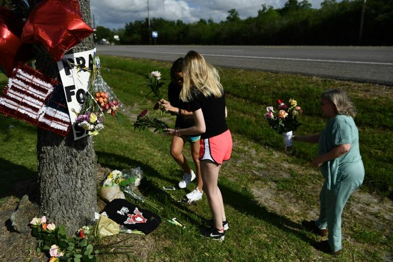 Residents leave flowers at a memorial for victims of a mass shooting at Santa Fe High School in Santa Fe, Texas