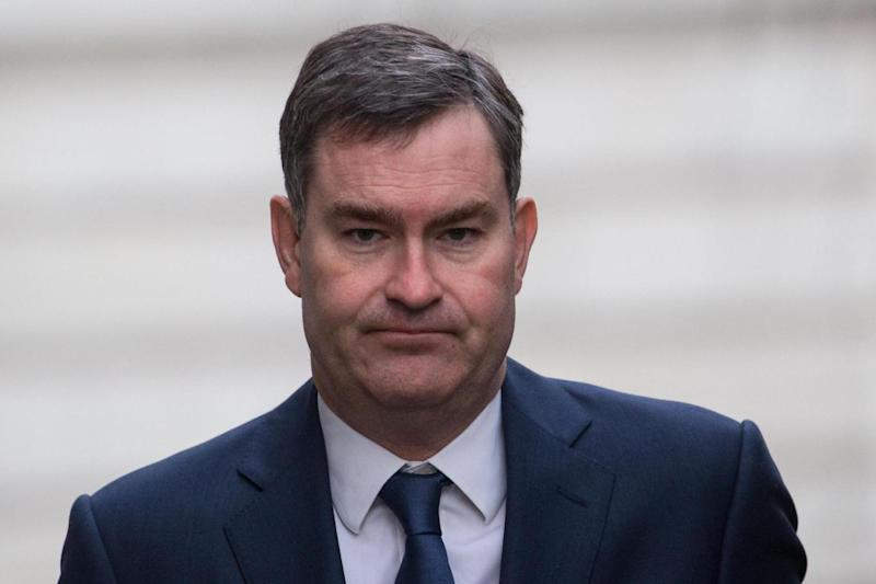 David Gauke said manipulative parents were trying to brainwash their sons and daughters towards extremism (Rex Features)