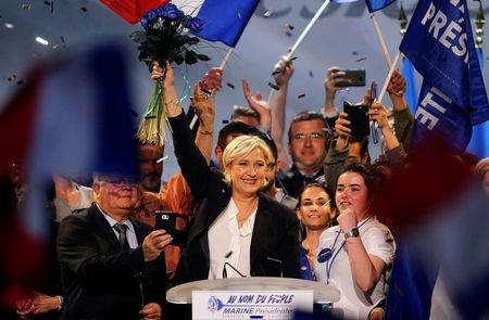 Marine Le Pen, French National Front (FN) political party leader and candidate for French 2017 presidential election, waves to supporters at the end of a political rally in Bordeaux