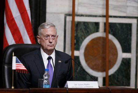 FILE PHOTO: Mattis listens to question during joint news conference in New Delhi