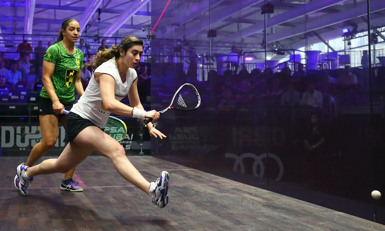 Nour el-Sherbini of Egypt (R) plays a backhand against her compatriot Raneem al-Welily during their match of the Dubai PSA World Series Finals squash tournament in Dubai on May 24, 2016. (AFP Photo/MARWAN NAAMANI)