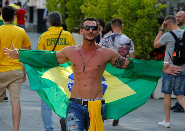 A Brazil fan celebrates victory of his team over Costa Rica at the World Cup Group E soccer match in central Moscow, Russia June 22, 2018. REUTERS/Sergei Karpukhin