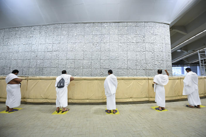 Muslim pilgrims cast stones at a pillar in the symbolic stoning of the devil, the last rite of the annual hajj, and the first day of Eid al-Adha, in Mina near the holy city of Mecca, Saudi Arabia, Friday, July 31, 2020. The global coronavirus pandemic has cast a shadow over every aspect of this year's pilgrimage, which last year drew 2.5 million Muslims from across the world to Mount Arafat, where the Prophet Muhammad delivered his final sermon nearly 1,400 years ago. Only a very limited number of pilgrims were allowed to take part in the hajj amid numerous restrictions to limit the potential spread of the coronavirus. (Saudi Ministry of Media via AP)
