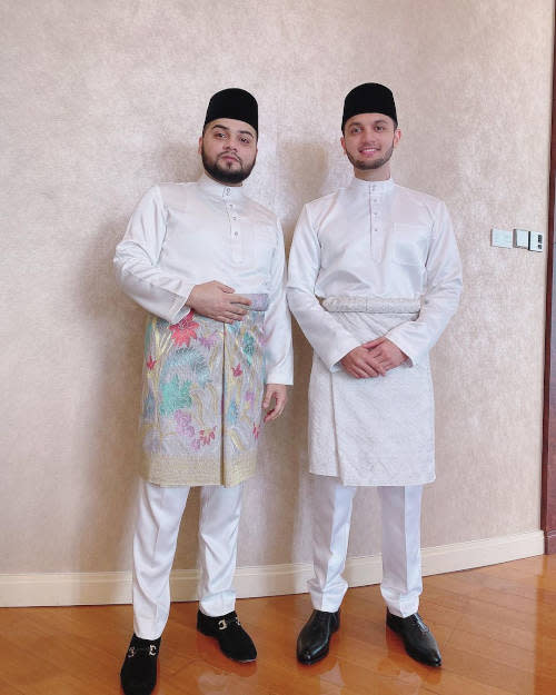 The groom (right) with a friend