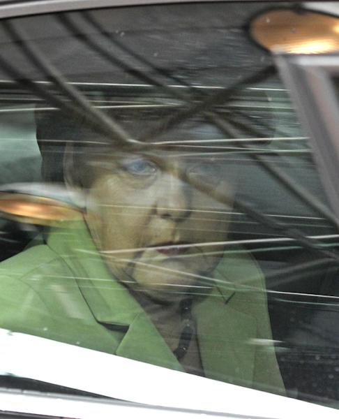 German Chancellor Angela Merkel looks out of her car window as she arrives for an EU summit in Brussels on Friday, June 28, 2013. After late night budget talks, European Union leaders are turning their attention away from their financial troubles Friday and toward embracing once-troubled Balkan countries. (AP Photo/Yves Logghe)