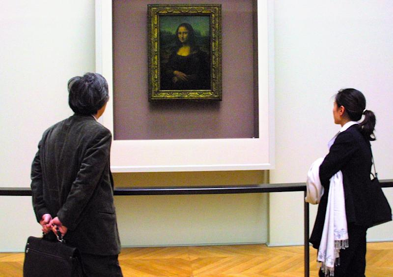 Known as La Gioconda in Italian, the Mona Lisa is often held up as a symbol of emotional enigma (AFP Photo/JOEL SAGET)