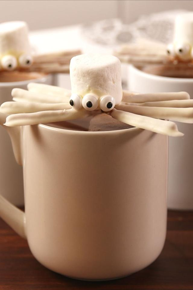 """<p>A must for Halloween hot cocoa.</p><p>Get the recipe from <a rel=""""nofollow"""" href=""""https://www.delish.com/cooking/recipe-ideas/recipes/a55856/halloweentown-marshmallow-spiders-recipe/"""">Delish</a>.</p><p><a rel=""""nofollow"""" href=""""https://www.amazon.com/Calphalon-Nonstick-Bakeware-Baking-2-Piece/dp/B008BUKO6G/?tag=delish_auto-append-20&ascsubtag=[artid