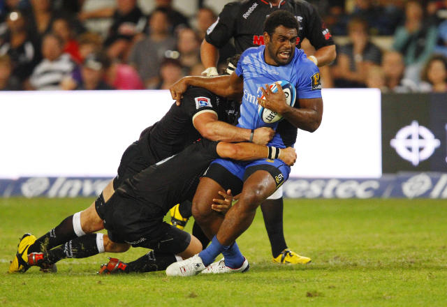 Western Force's Napolioni Nalaga is held in a tackle during the Super 15 Rugby Union match between Western Force of Australia and Coastal Sharks from Durban at the Kings Park in Durban on May 12, 2012. Coastal Sharks defeated Western Force 53-11. AFP PHOTO / STRINGERSTRINGER/AFP/GettyImages