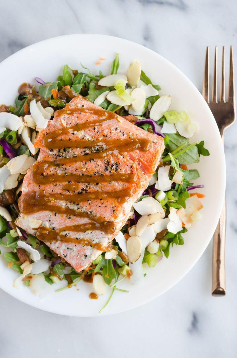 """<p>This easy recipe calls for pan frying the salmon fillets in a cast iron skillet (it takes just 6 to 8 minutes). Serve over salad with crunchy ingredients like sliced almonds and desiccated coconut, and drizzle with a tasty homemade peanut dressing.</p><p><strong>Get the recipe from <a href=""""https://www.thepioneerwoman.com/food-cooking/recipes/a97723/thai-inspired-salmon-salad/"""" rel=""""nofollow noopener"""" target=""""_blank"""" data-ylk=""""slk:Erica Kastner"""" class=""""link rapid-noclick-resp"""">Erica Kastner</a>.</strong> </p>"""