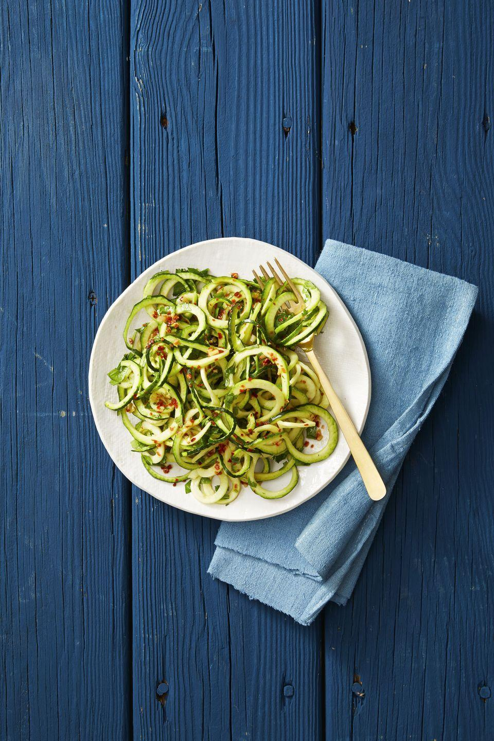 """<p>Transform spiralized zucchini into the vegan """"pasta"""" salad of your dreams by tossing zoodles with sesame oil, vinegar, garlic, cilantro and red pepper flakes.<br></p><p><em><a href=""""https://www.goodhousekeeping.com/food-recipes/a38869/asian-sesame-zucchini-noodles-recipe/"""" rel=""""nofollow noopener"""" target=""""_blank"""" data-ylk=""""slk:Get the recipe for Asian Sesame Zucchini Noodles »"""" class=""""link rapid-noclick-resp"""">Get the recipe for Asian Sesame Zucchini Noodles »</a></em></p><p><strong>RELATED: </strong><a href=""""https://www.goodhousekeeping.com/food-recipes/g562/zucchini-recipes/"""" rel=""""nofollow noopener"""" target=""""_blank"""" data-ylk=""""slk:40 Healthy and Delicious Zucchini Recipes"""" class=""""link rapid-noclick-resp"""">40 Healthy and Delicious Zucchini Recipes</a></p>"""