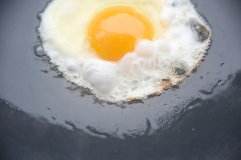 Egg frying in oil.
