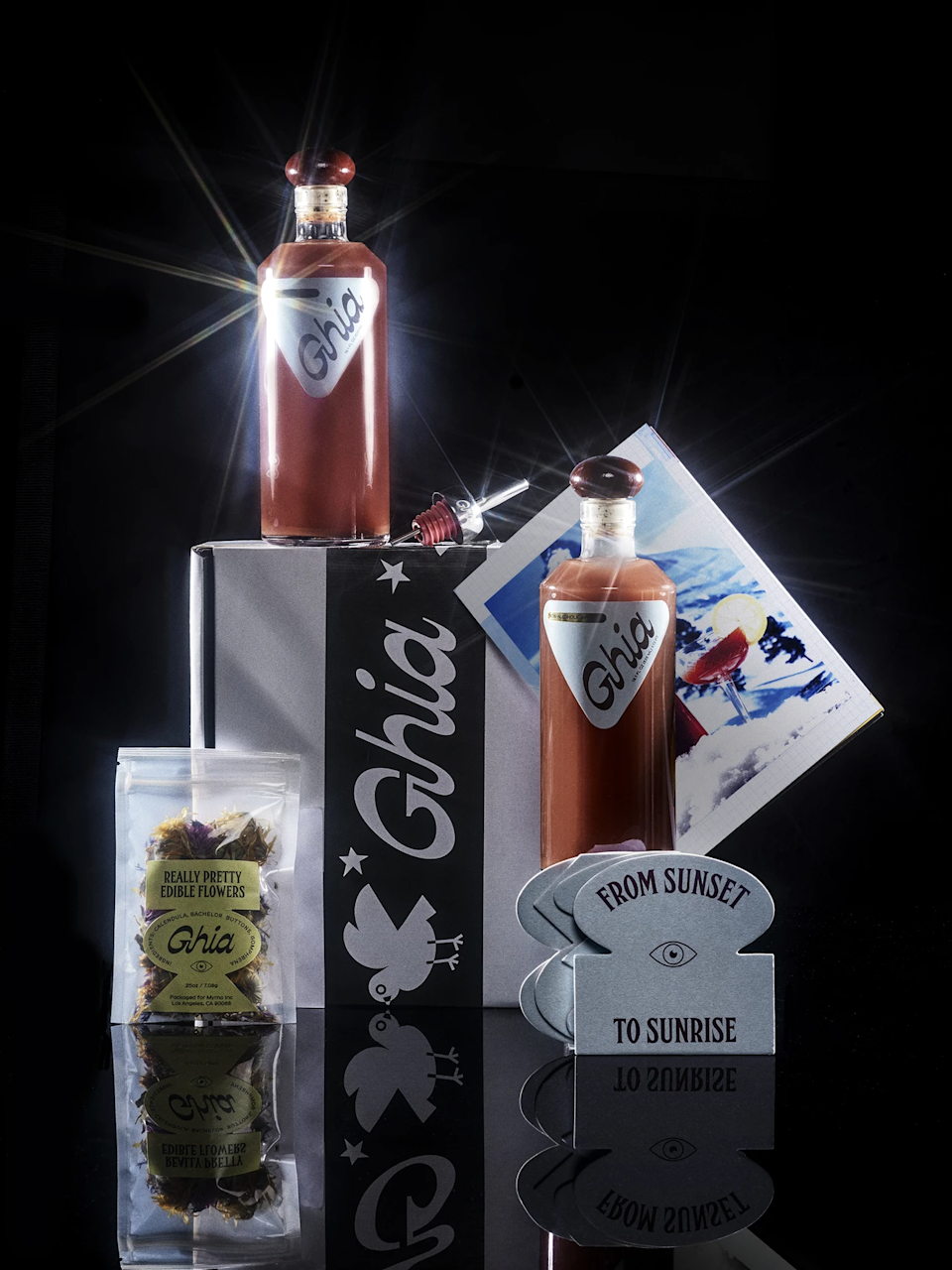 """<h3>Ghia Holiday Box</h3><br>Ghia makes beautifully crafted spirit-free aperitifs perfect for the holiday season. Their holiday box includes bar cart essentials like coasters, a custom holiday pour spout, dried edible flowers, a chef-curated recipe book, and of course their signature aperitif. <br><br><strong>Ghia</strong> Holiday Box, $, available at <a href=""""https://go.skimresources.com/?id=30283X879131&url=https%3A%2F%2Fdrinkghia.com%2Fproducts%2Fholiday-box"""" rel=""""nofollow noopener"""" target=""""_blank"""" data-ylk=""""slk:Ghia"""" class=""""link rapid-noclick-resp"""">Ghia</a>"""