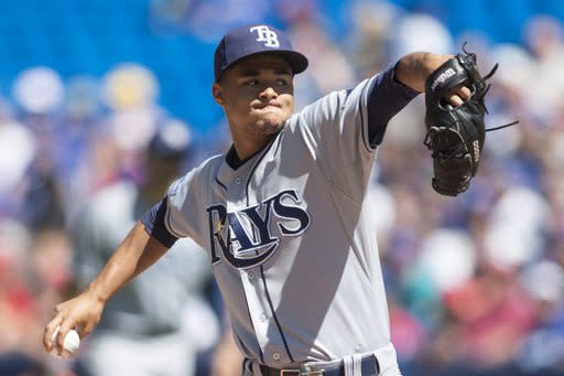 Tampa Bay Rays starting pitcher Chris Archer works against the Toronto Blue Jays during first-inning baseball game action in Toronto, Sunday, Aug. 24, 2014. (AP Photo/The Canadian Press, Chris Young)