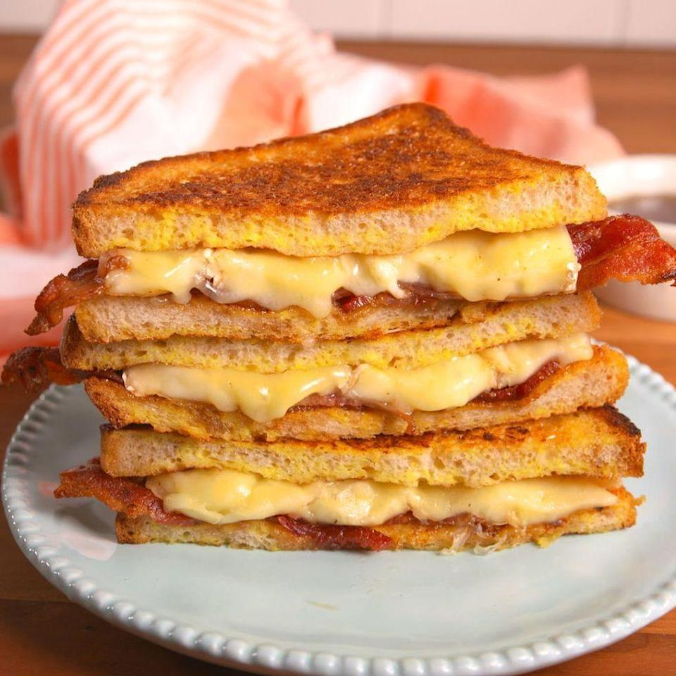 """<p>Not your grandma's grilled cheese. (Unless your grandma is fancy.)</p><p>Get the <a href=""""https://www.delish.com/uk/cooking/recipes/a29782662/french-toast-grilled-cheese-recipe/"""" rel=""""nofollow noopener"""" target=""""_blank"""" data-ylk=""""slk:French Toast Grilled Cheese"""" class=""""link rapid-noclick-resp"""">French Toast Grilled Cheese</a> recipe.</p>"""